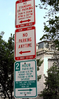Note That The Top Sign Says No Standing Or Parking In Morning Afternoon But Bottom 2 Hour Is OK During Same Period